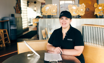 Chipotle employee smiling while earning a debt-free degree