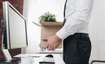 Dissapointed businessman clearing his desk after being made redundant